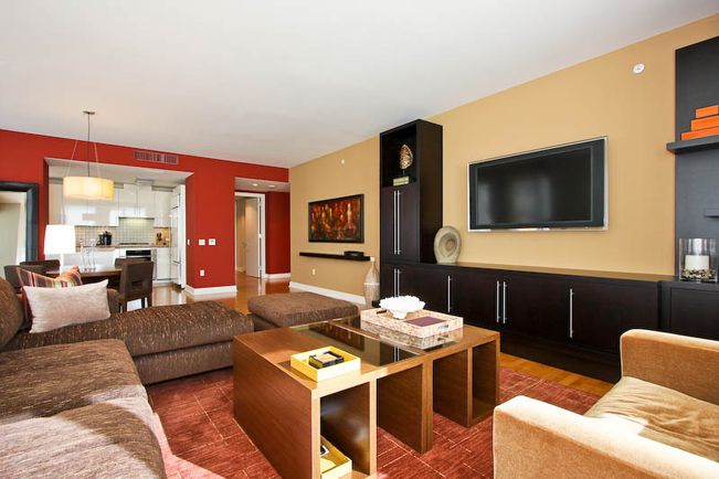 red accent wall, accent wall, interior design, san francisco interior design, high-rise, custom furniture, custom media unit, media unit, flat screen t.v., custom coffee table, unique coffee table